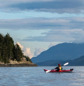 Kayaker heading to camp in Johnstone Strait
