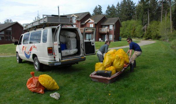 Carrying beach garbage to van